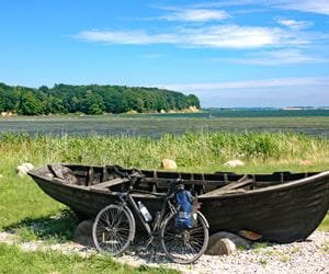 Bike in front of boat at the Baltic sea