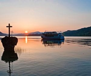 Sunset and ship at Mondsee Lake