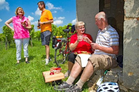 Cyclist having a break with a glass of wine