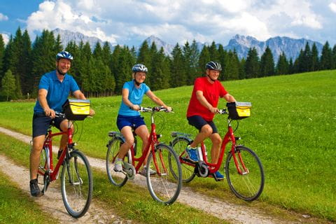 Three bikers on the cycle path through the Werdenfelser Land