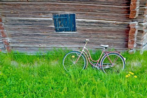 Old bike in front of a barn