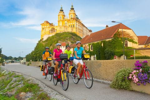 Cyclist in front of Melk Abbey