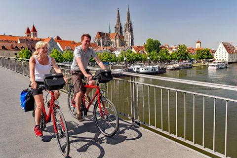 Cyclists on bridge on their way to Regensburg