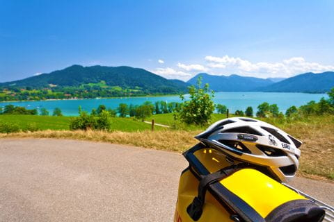 Eurobike helmet and pannier with view on the Tegernsee