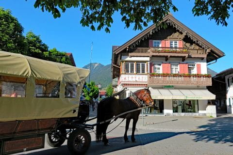 Horse-drawn carriage in the center of Garmisch Partenkirchen