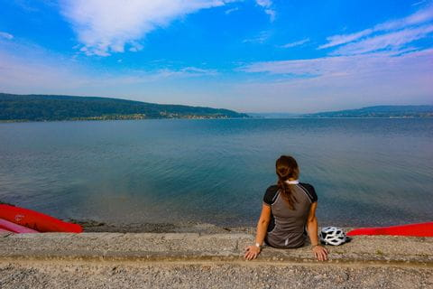 cyclist sitting at the lake