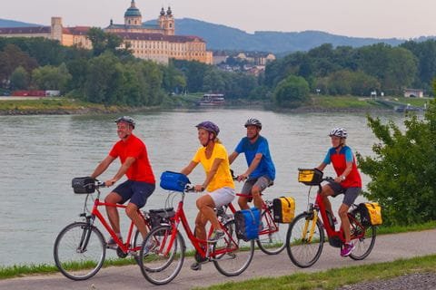 Cyclists on the Danube Cycle Path with Abbey Melk