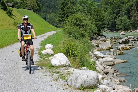 Cyclist on a cycle path along a river