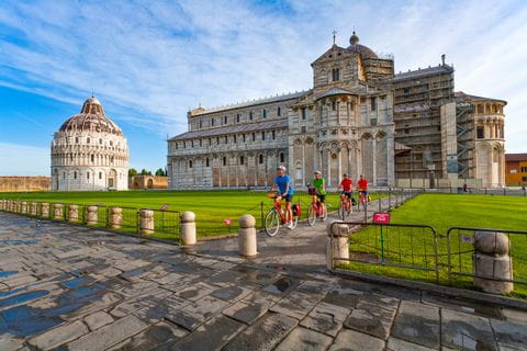 Cyclists in the Piazza dei Miracoli