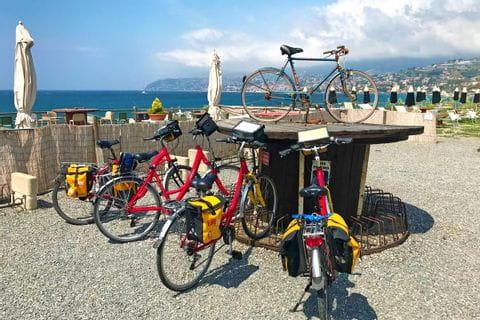 Bikes at a kickstand along the coast