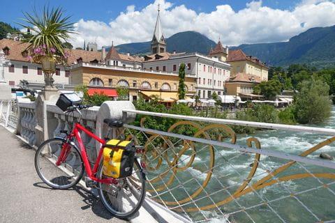 Bike leans on bridge in merano