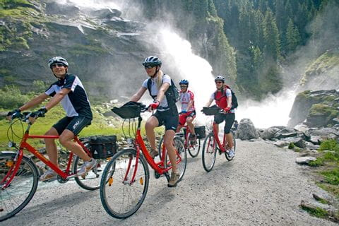 Cyclists in front of waterfalls