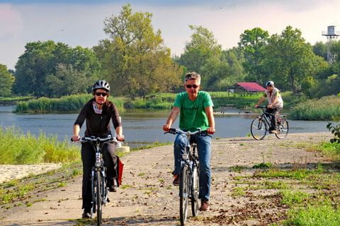 Cyclists on river-cycle path
