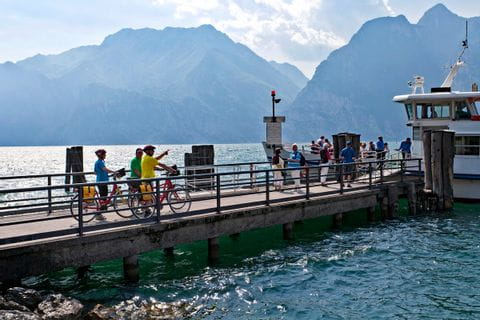 Cyclists going to the ferry at Lake Garda