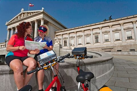 Cyclists in front of the Viennese Parliament