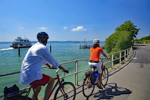 Cyclists on cycle path near Meersburg at the bank of Lake Constance