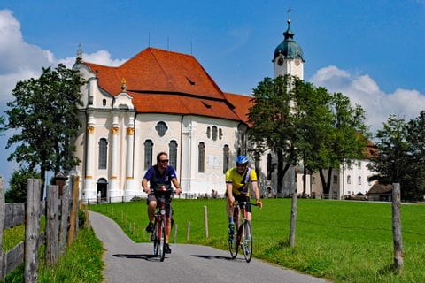 Cyclists in front of the church Wieskirche