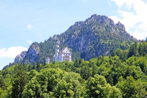 Neuschwanstein Castle with mountain panorama