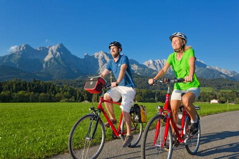 Cyclists with mountains in the background