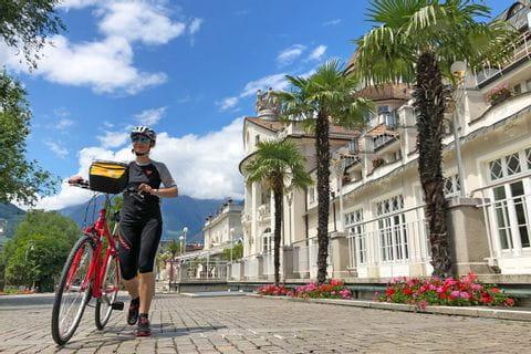 Cyclist at main square in Merano