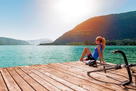 Cyclist relaxing on a runway at Lake Ossiach
