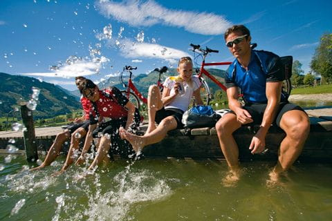 Cyclists splashing their legs in the water