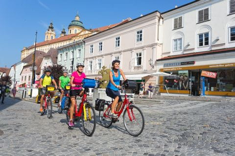 Cyclists in Melk with Abbey