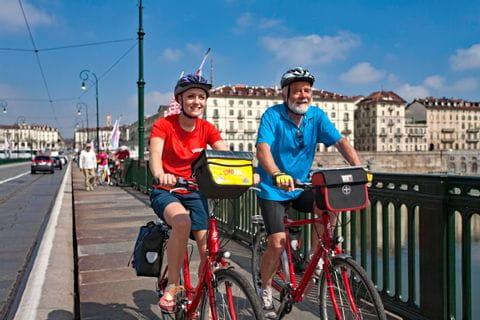 Cyclists on the bridge Ponte Vittorio Emanuele