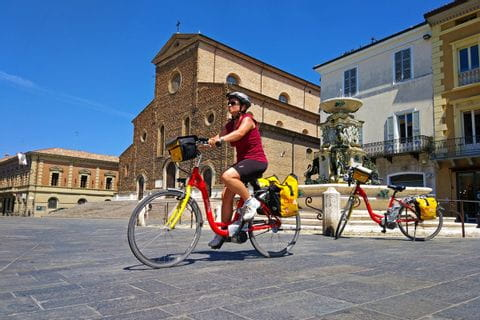 Cyclist at the market square of Faenza