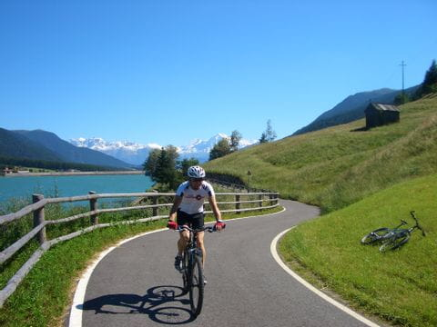 Cycle path along the blue Lake Resia