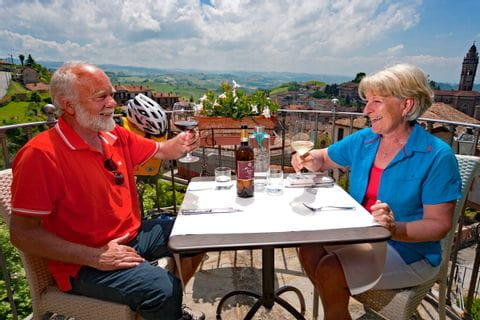 Cyclists enjoying food and a glass of wine