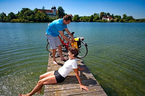 Eurobike cyclists having a break on a runway at Lake Chiemsee