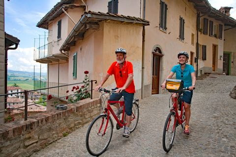 Cyclists in the old town of Montforte d'Alba