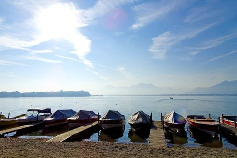 Boats on the riverside of the lake chiemsee