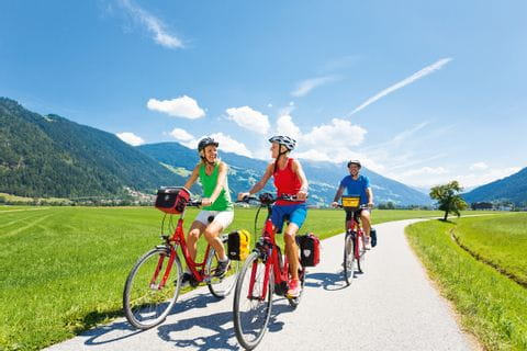 Group of cyclists on the way on the Tauern Cycle Path