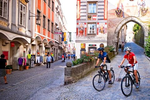 Cyclists passing a town gate