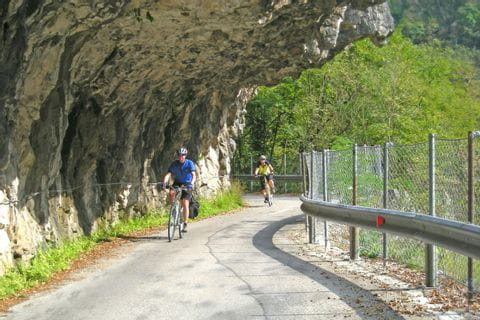 Cycle path along a rock wall