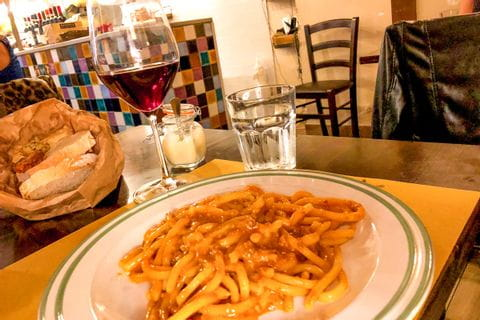 Italian dinner with a glass of wine