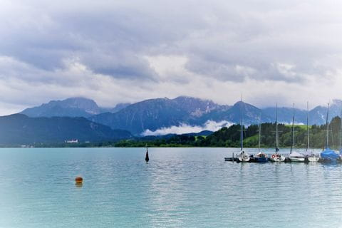 Forggensee with mountains