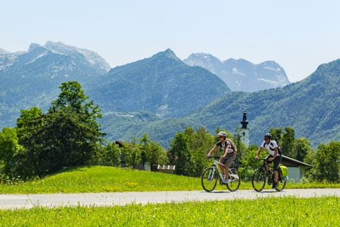 Cyclists in front of panoramic view over the mountains