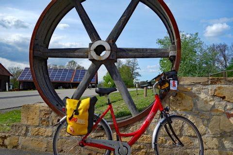 Eurobike-bike in front of wooden wheel