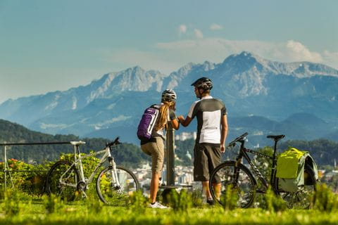 Two cyclists in front of panoramic view