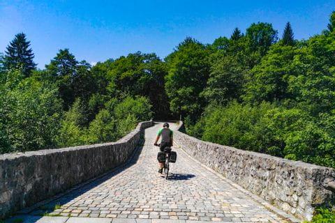 biker on a stone bridge
