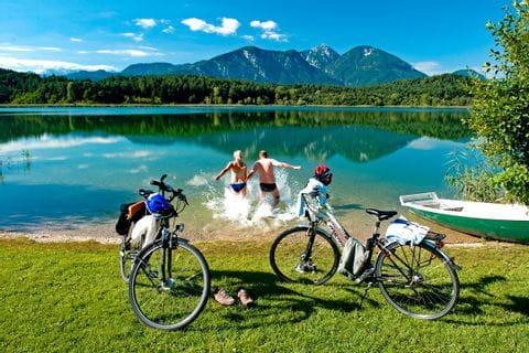Cyclists splashing in a lake