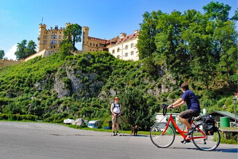 Eurobike cyclist in front of Castle Hohenschwangau