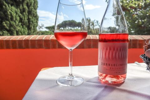 Rose wine with view of the Tuscan countryside